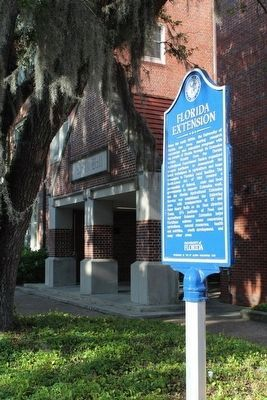 Florida Extension Marker with Rolfs Hall behind image. Click for full size.