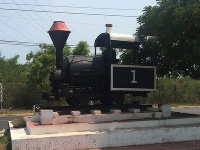 A small train locomotive near the Acajutla marker. image. Click for full size.