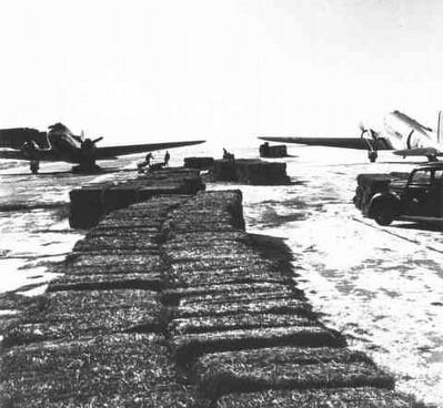 Bales were sometimes dropped on the range near stranded cattle. image. Click for full size.