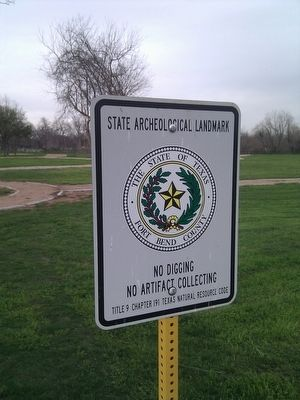 Sign protecting the archeological park behind the levee. image. Click for full size.