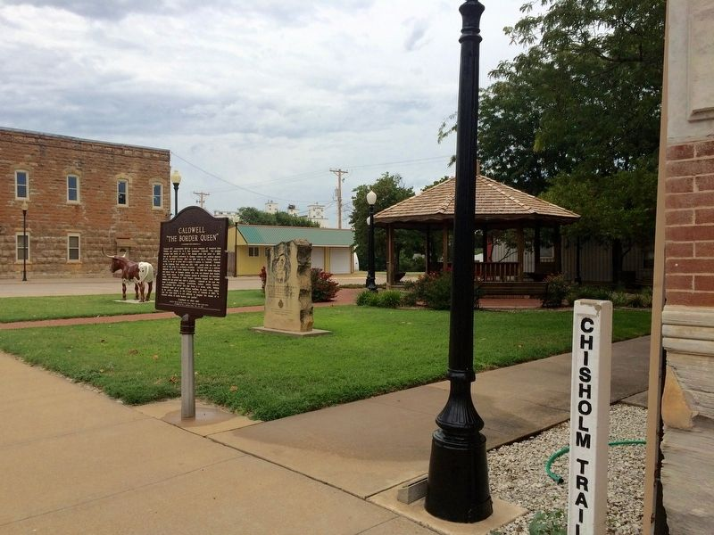 Marker view of small park and Chisholm Trail markers. image. Click for full size.