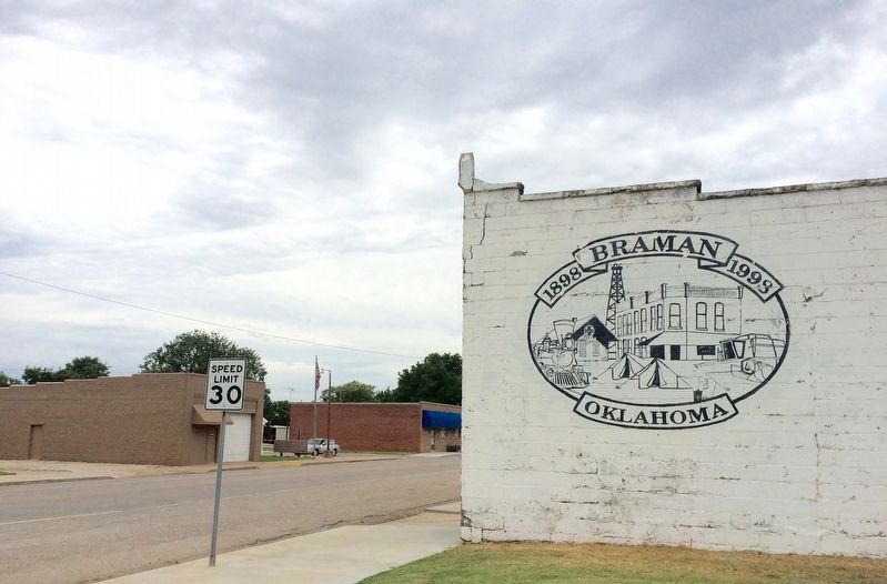 Braman mural with marker in deep background. image. Click for full size.