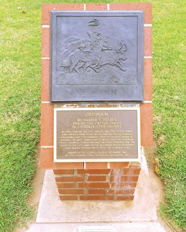 Chisholm Marker monument with cattle drive relief. image. Click for full size.