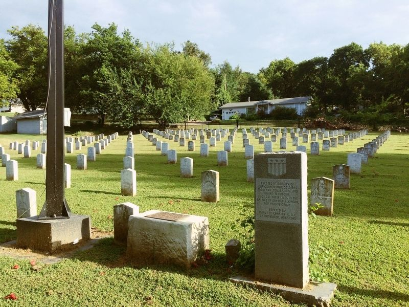 Memorial in front of Confederate grave markers. image. Click for full size.