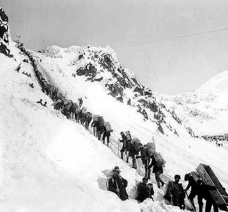 Klondikers carrying supplies ascending the Chilkoot Pass image. Click for full size.