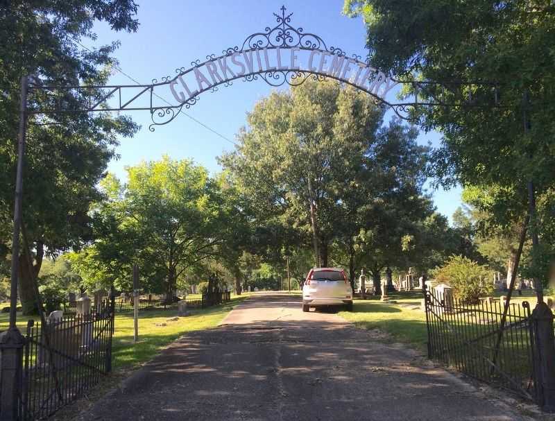 Clarksville Cemetery entrance gate. Page's Tree is to extreme right. image. Click for full size.