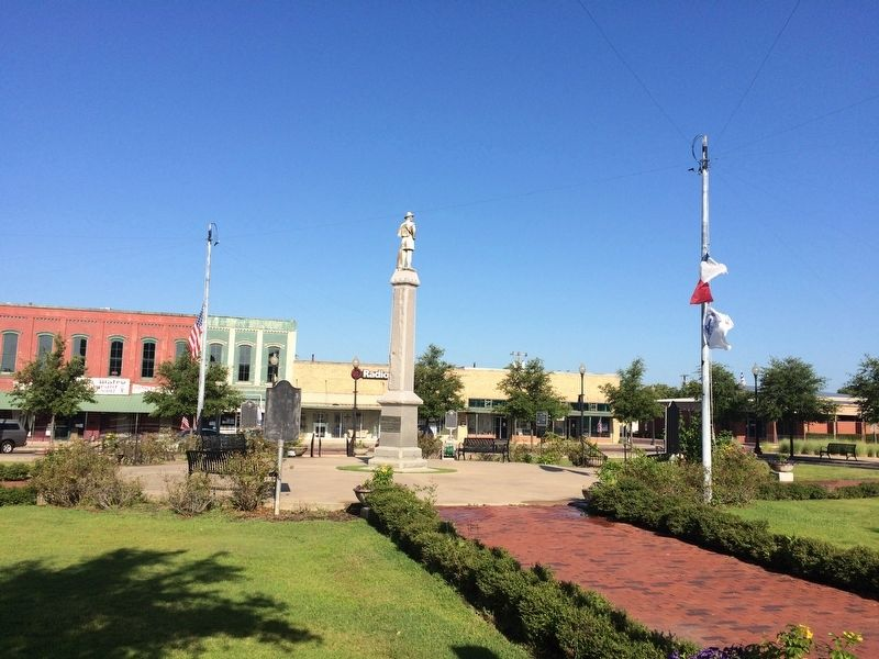 View of town square and this marker near Texas flag. image. Click for full size.