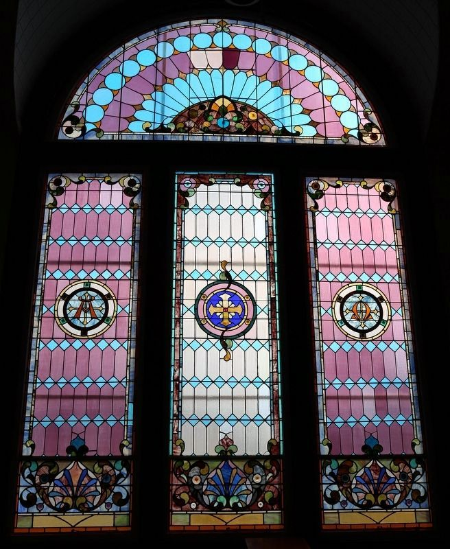 One of the three large stained glass windows image. Click for full size.
