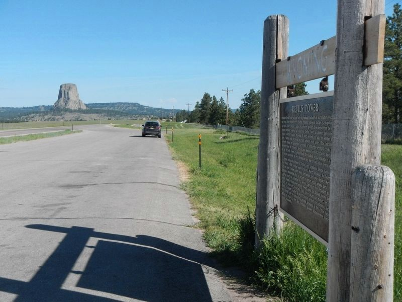 Devils Tower, in the distance, and Marker image. Click for full size.