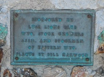 Plaque on the base of the Texas Trail Monument image. Click for full size.