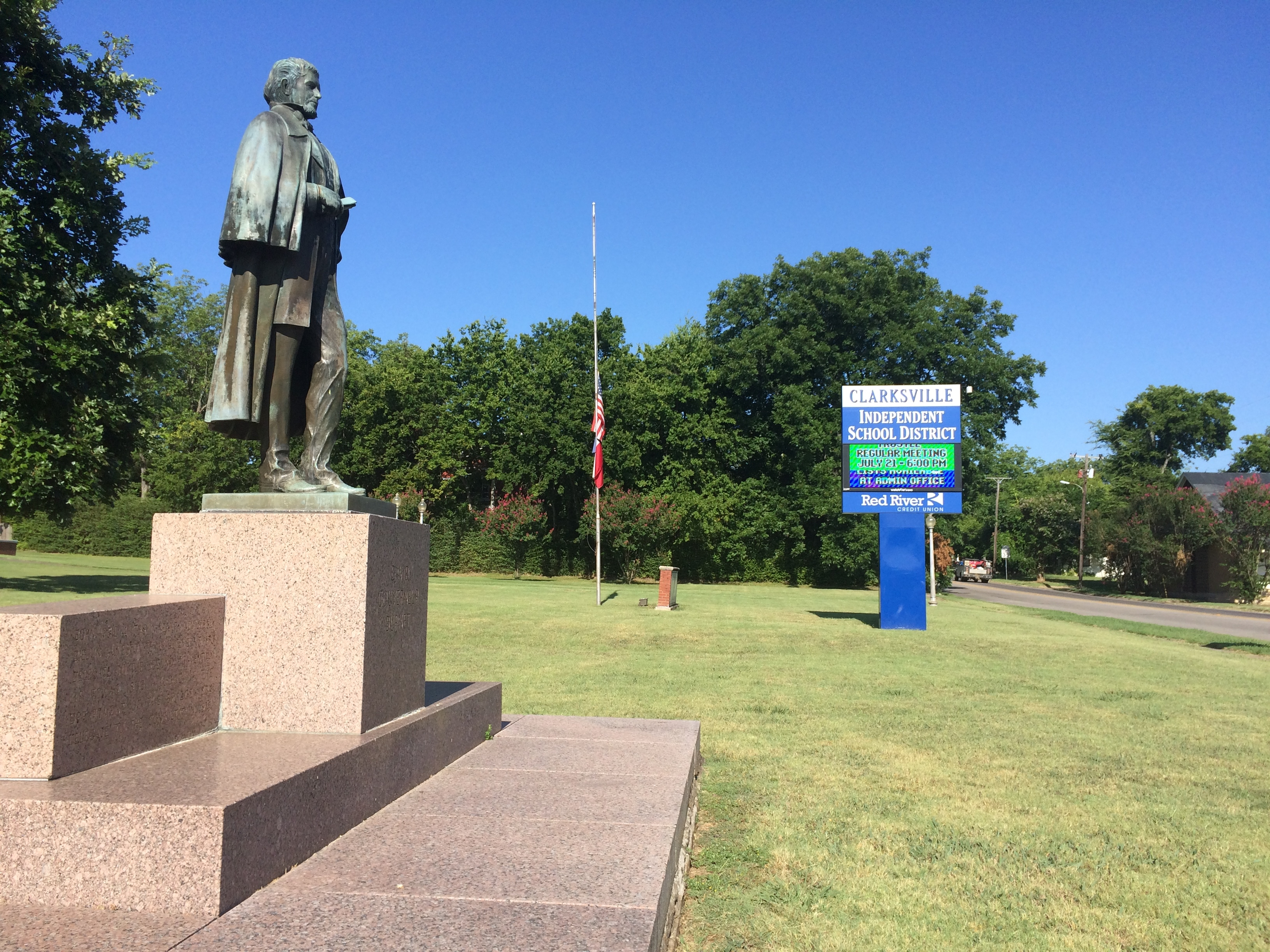 David Gouverneur Burnet statue and Clarksville High School sign.