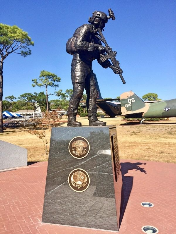 Memorial showing the USAF Pararescue & Special Operations Weather emblems. image. Click for full size.