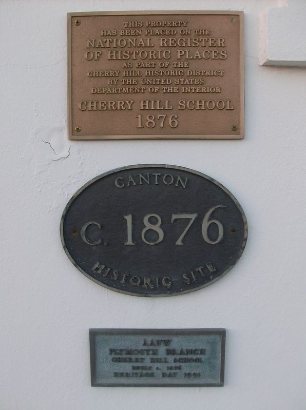 Plaques at the left of the main door image. Click for full size.