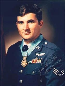 Airman First Class John Lee Levitow wearing the Medal of Honor. image. Click for full size.