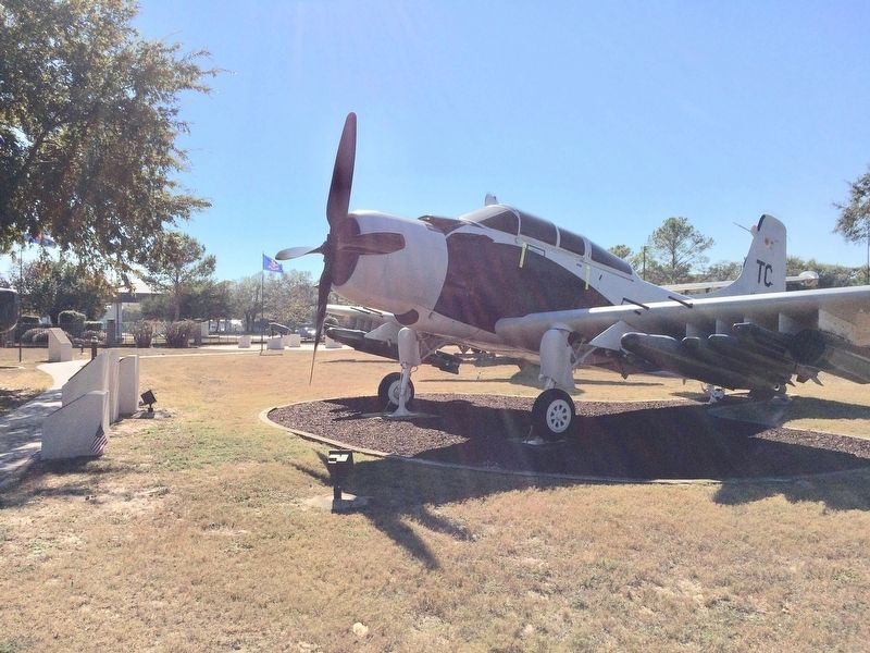 Marker and A-1E Skyraider aircraft. image. Click for full size.