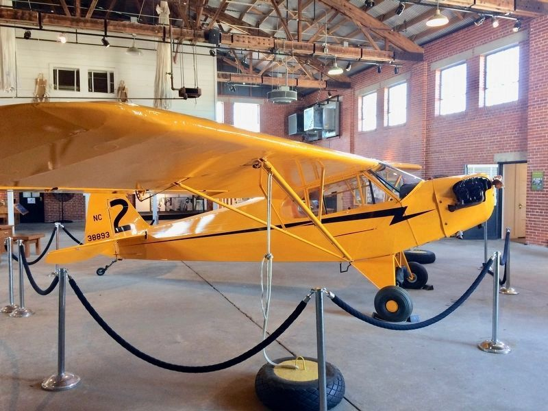 "Piper J-3 ""Cub' airplane used in the training of the Tuskegee Airmen. image. Click for full size."