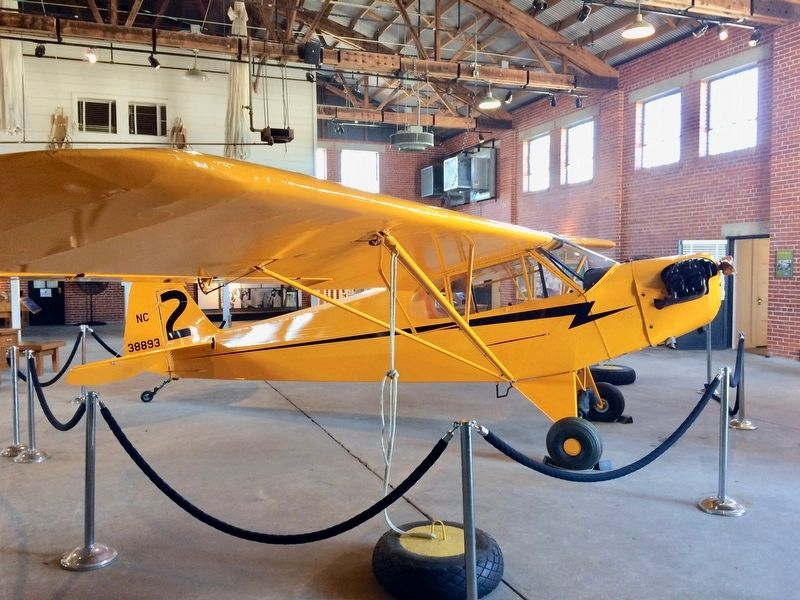 "Piper J-3 ""Cub"", located in the Hangar 1 museum (similar to one on marker). image. Click for full size."
