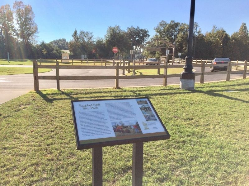 Bagdad Mill Site Park marker looking towards park entrance gate. image. Click for full size.