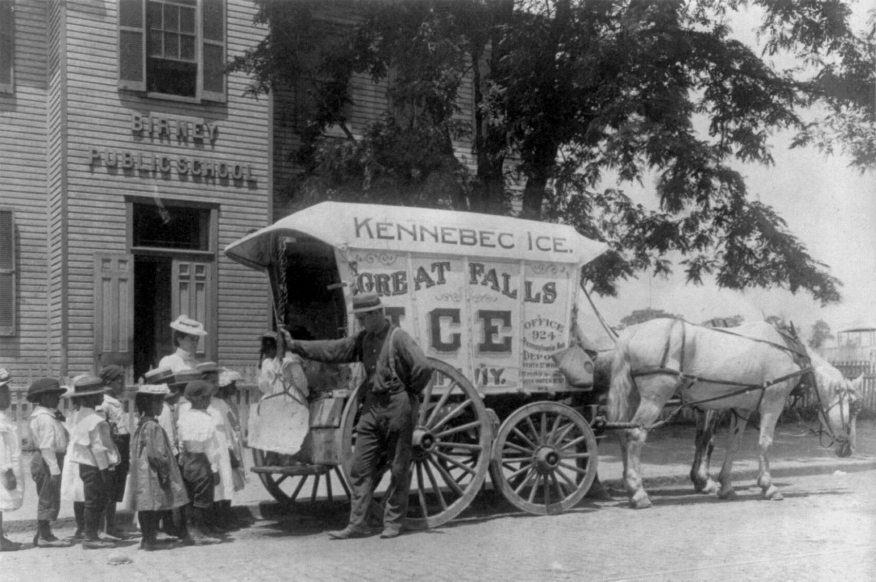 Students learn about the ice cream man in front of the original Birney School 1899. image. Click for full size.