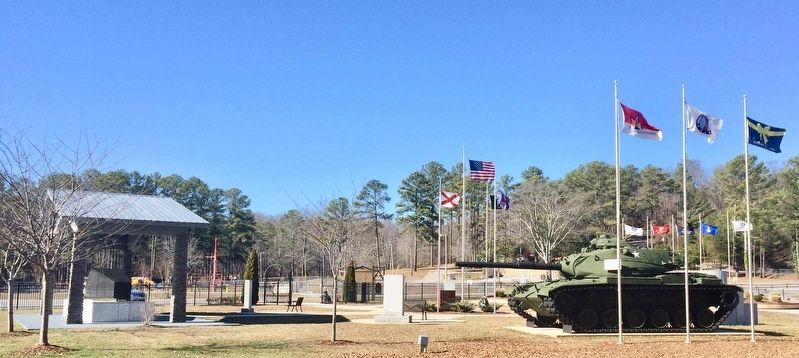Purple Heart monument below the State of Alabama flag. image. Click for full size.