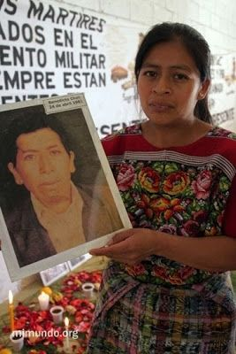 Angelica Chalí shows a photo of her grandfather Benedicto Chalí, murdered on April 24, 1981. image. Click for full size.