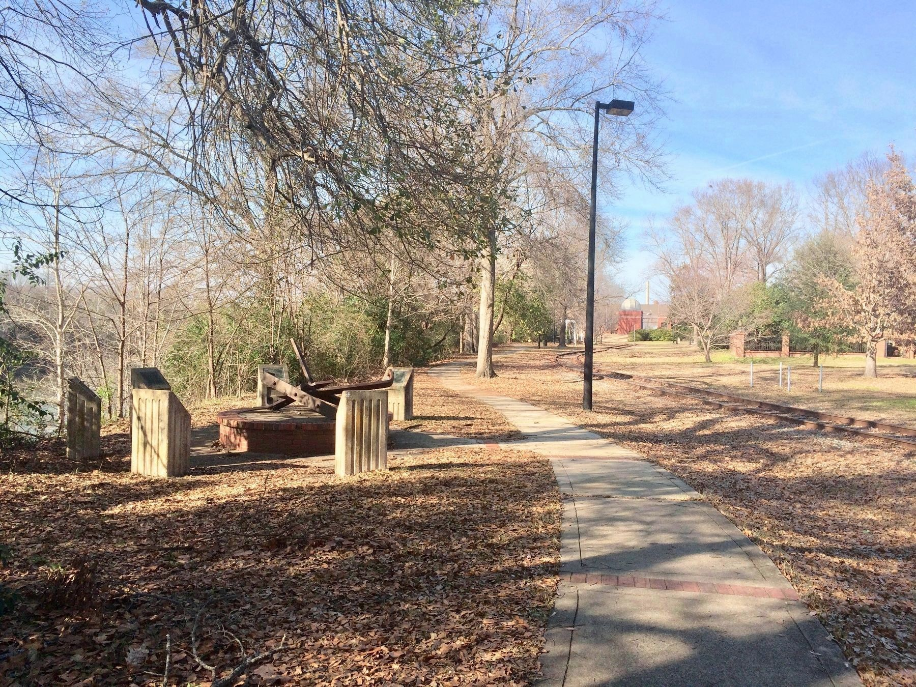 Carson McCullers Marker, on far left, along railroad tracks. image. Click for full size.