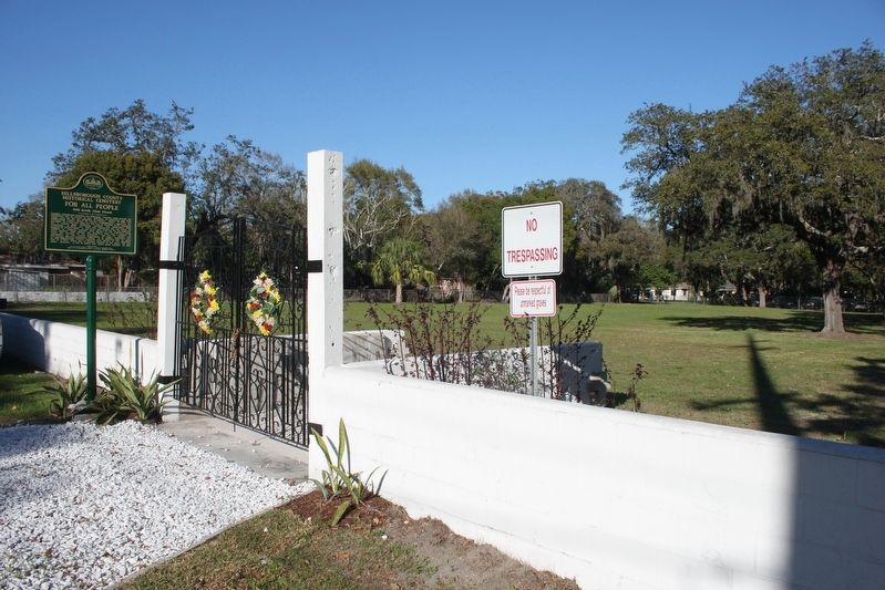 Hillsborough County Historical Cemetery For All People Marker and cemetery behind wall. image. Click for full size.