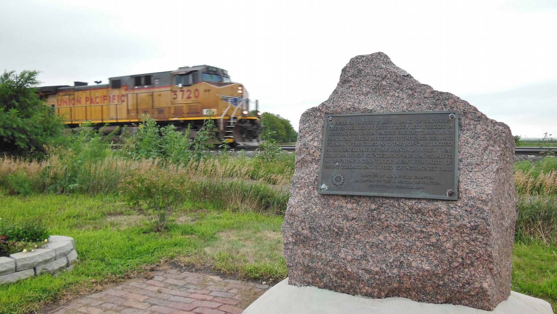 West-bound Union Pacific freight train passing the marker, 146 years later! image. Click for full size.