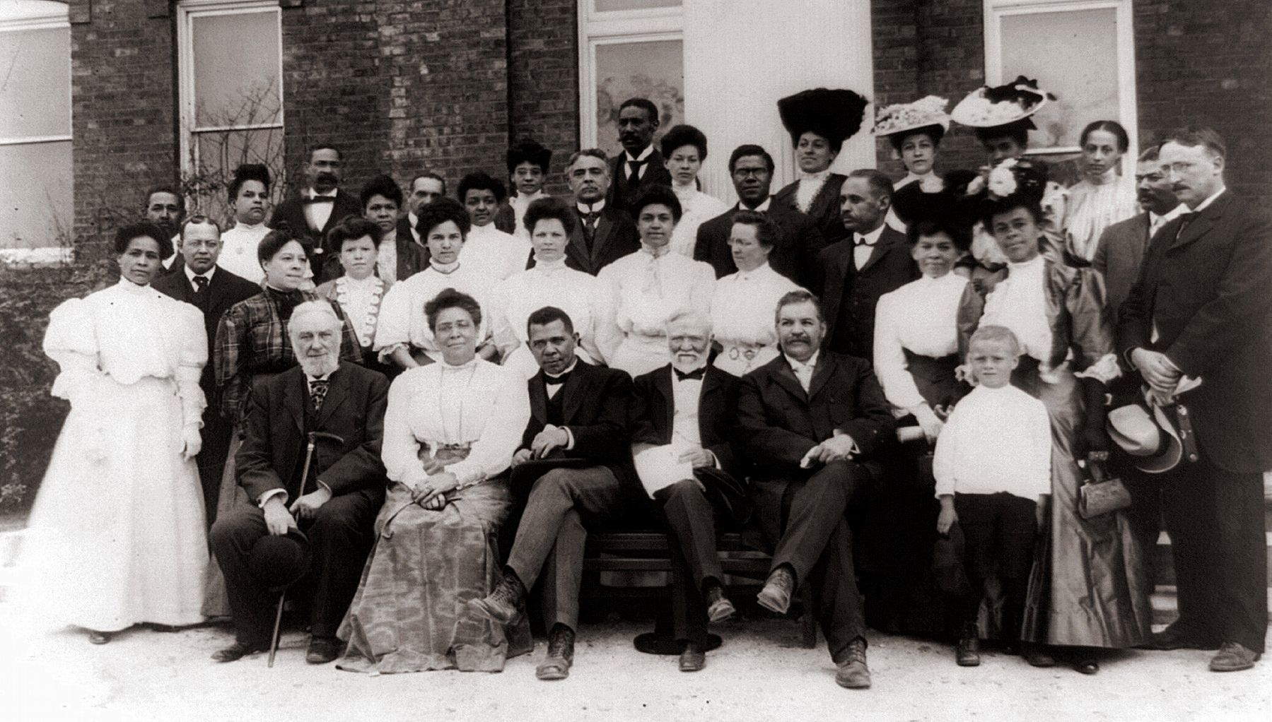 Carnegie with African-American leader Booker T. Washington visiting Tuskegee Institute faculty. image. Click for full size.