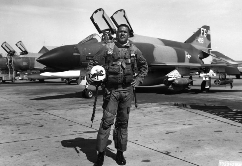 "General Daniel ""Chappie"" James, Jr. in front of his McDonnell-Douglas F-4C Phantom II. image. Click for full size."