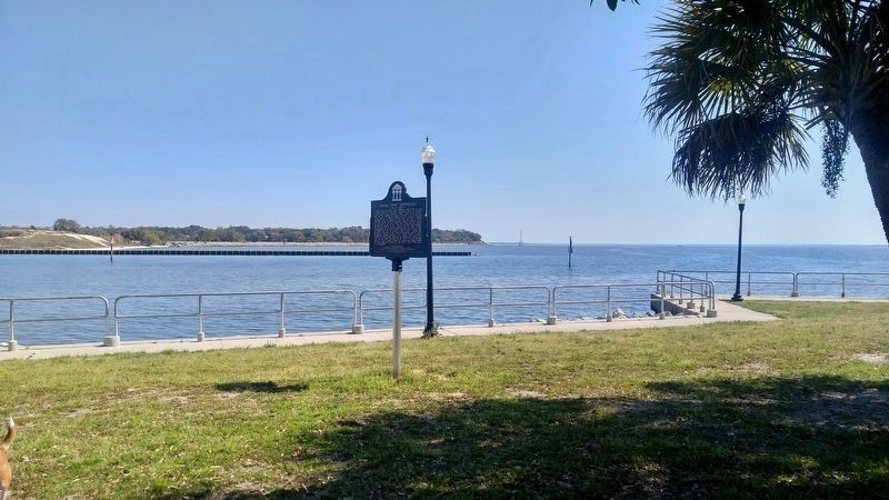 View of marker and Pensacola Bay shipwreck area in background. image. Click for full size.