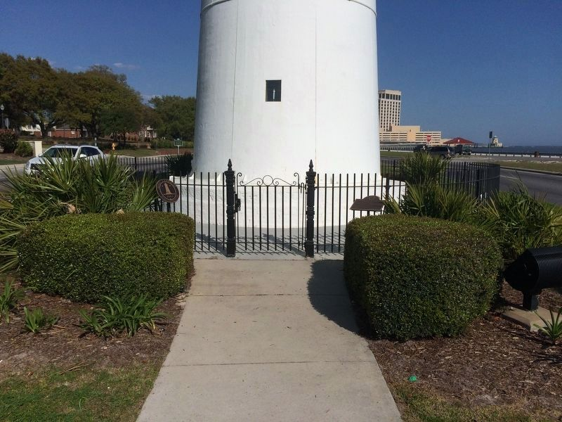 Biloxi Lighthouse closeup showing metal plaques. image. Click for full size.