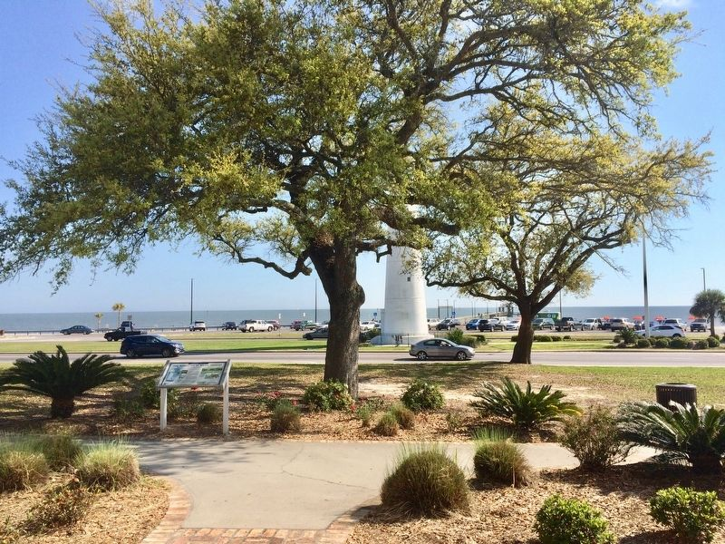 View of marker and Biloxi Lighthouse with Gulf of Mexico in background. image. Click for full size.