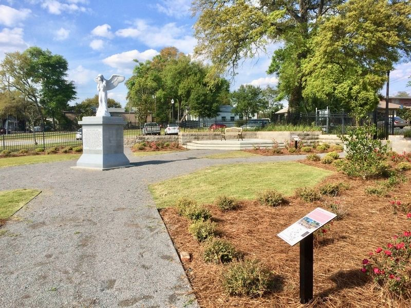 View of former cemetery and French Colonial memorial statue. image. Click for full size.