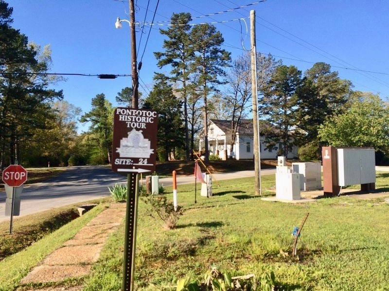 Betty Allen stone (to right of fiber cable marker) along with Pontotoc Historic tour sign. image. Click for full size.