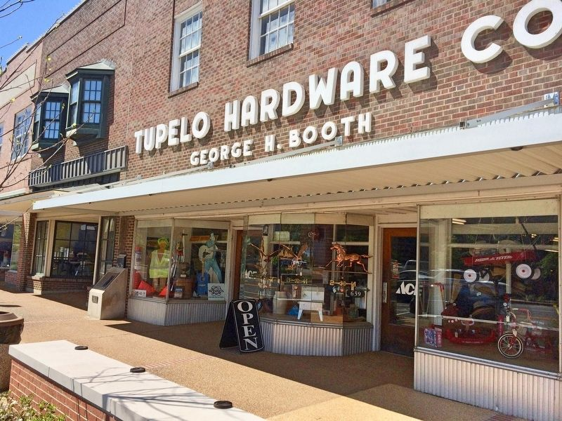 Tupelo Hardware Elvis Marker at left end of store. image. Click for full size.