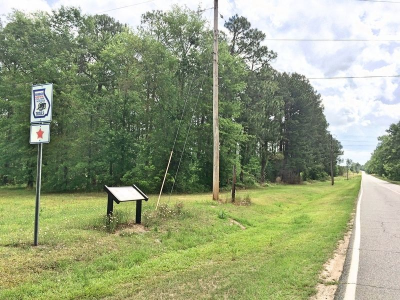View of marker, looking east on Old Savannah Road, towards 15th Corps campground area. image. Click for full size.