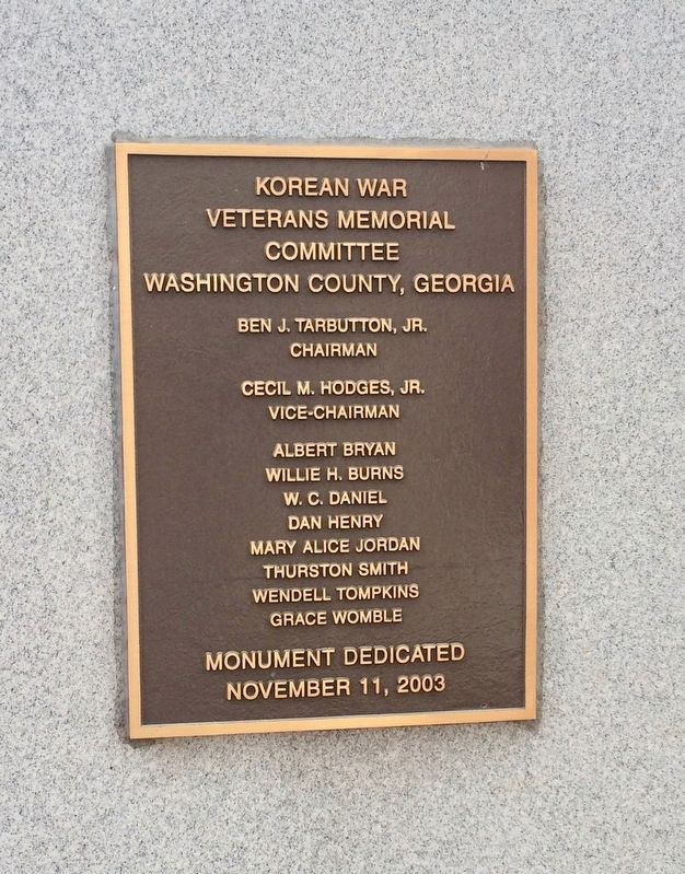 Dedication plaque located on rear of memorial. image. Click for full size.
