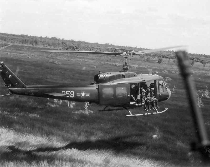 Vietnam Air Force (VNAF) UH-1H lands during a combat mission in Southeast Asia in 1970. image. Click for full size.