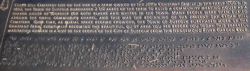 A detail view of the inscription and Braille lettering. image. Click for full size.