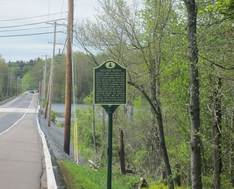 Sullivan Bridge Marker, with modern day bridge in background. image. Click for full size.