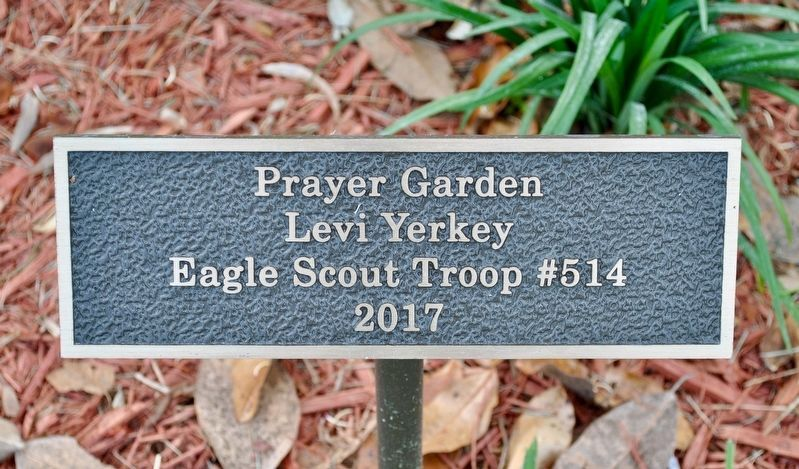 Plaque honoring the designer of the Prayer Garden. image. Click for full size.