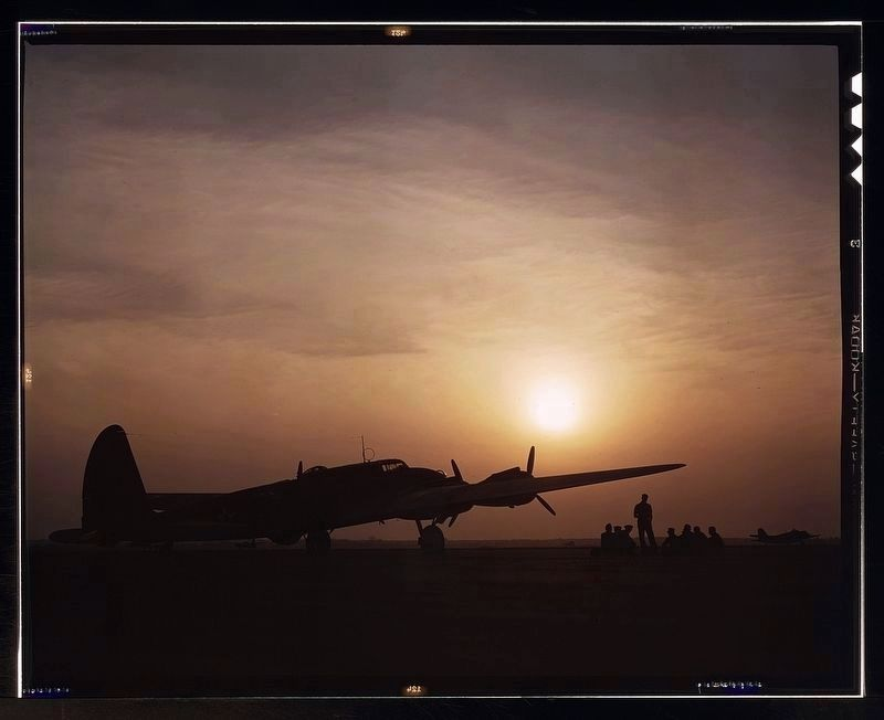 Sunset silhouette of flying fortress, Langley Field, Va. image. Click for full size.