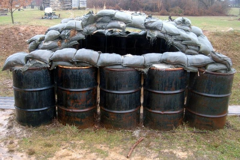 A sandbag and oil drum bunker image. Click for full size.