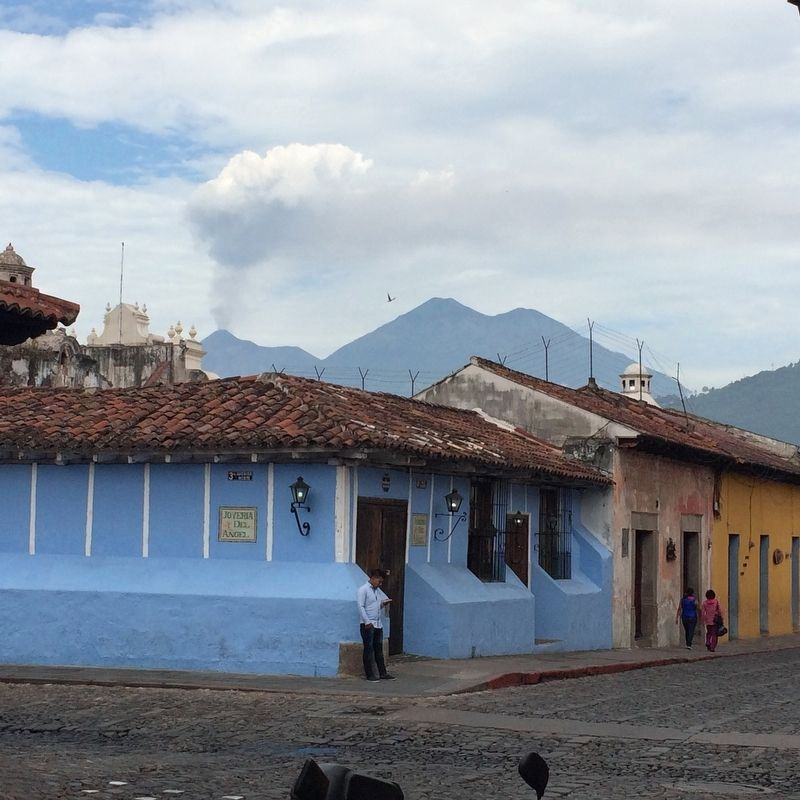 Volcanos Fuego and Acatenango seen to the southwest from the center of Antigua. image. Click for full size.
