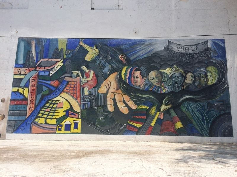 A nearby mural with a workers' rights theme image. Click for full size.