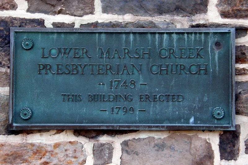 Marker on the wall of the original church building. image. Click for full size.