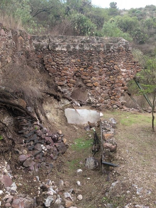 A remaining portion of the aqueduct that carried water to the mill. image. Click for full size.