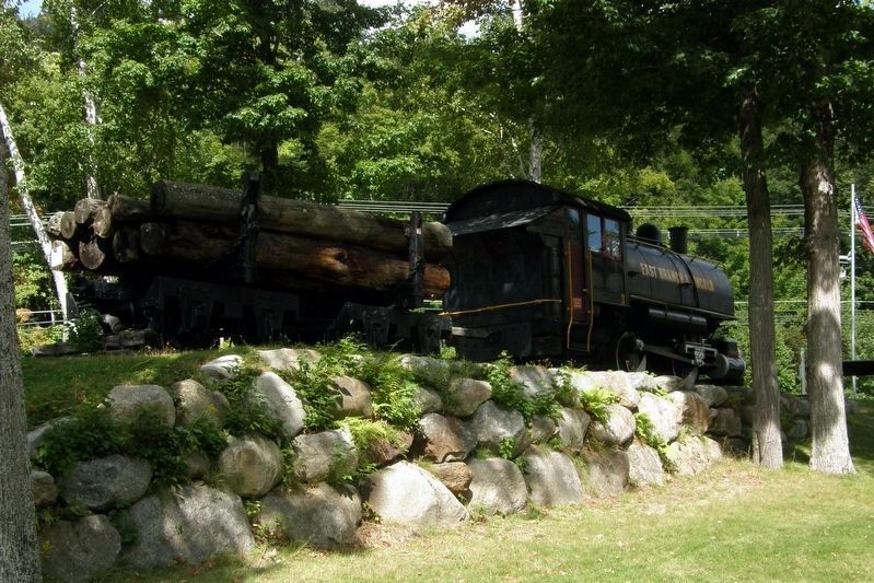 Nearby, an engine and log car. image. Click for full size.