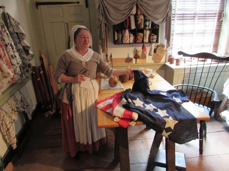 Betsy Ross with her flag image. Click for full size.